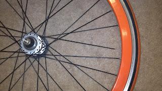 bicycle wheel with broken spoke