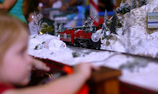 Child watching Toy Train at Santa Land at Bass Pro Shops