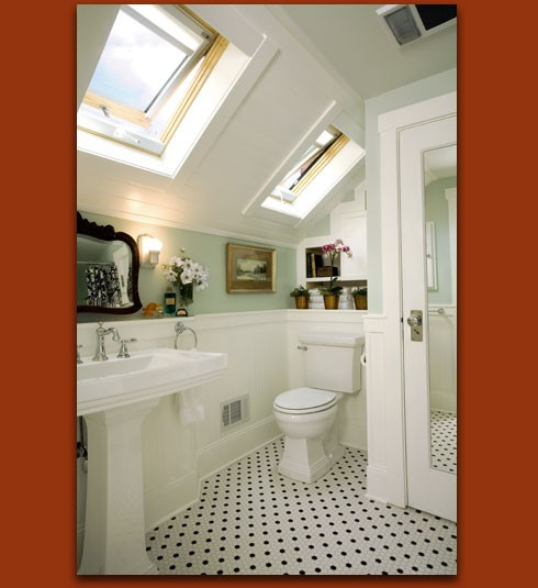 An attic bath by Donna DuFresne Interior Design  houzz com   The style is  classic cottage  Ample light comes in from the skylights  Just charming. Attic Works  Attic bathrooms