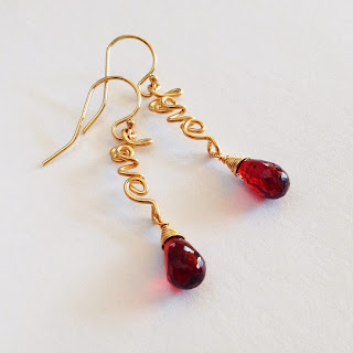 https://www.etsy.com/listing/175683082/gold-love-with-garnet-earrings-14k-gold?ref=shop_home_feat_1