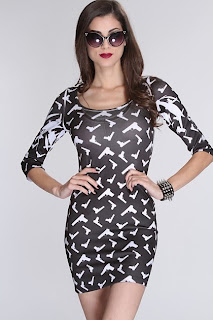 http://vixxenclothing.com/products/black-white-gun-print-3-4-sleeves-fitted-dress