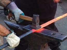 blacksmith hot iron hammer