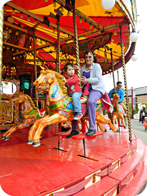 Small boy and Grandma on the Victorian Carousel at Tatton Park
