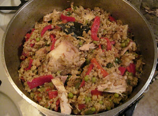 cooking arroz con pollo Cuban chicken & rice