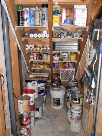 11 ways to organize under your stairs organizing made for Building shelves under stairs