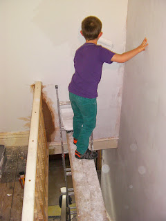 dangerous position for child painting over open staircase