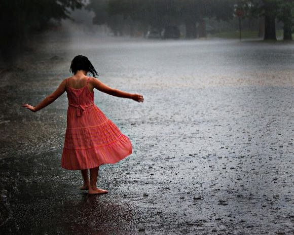 Girl Enjoying Rainy season India