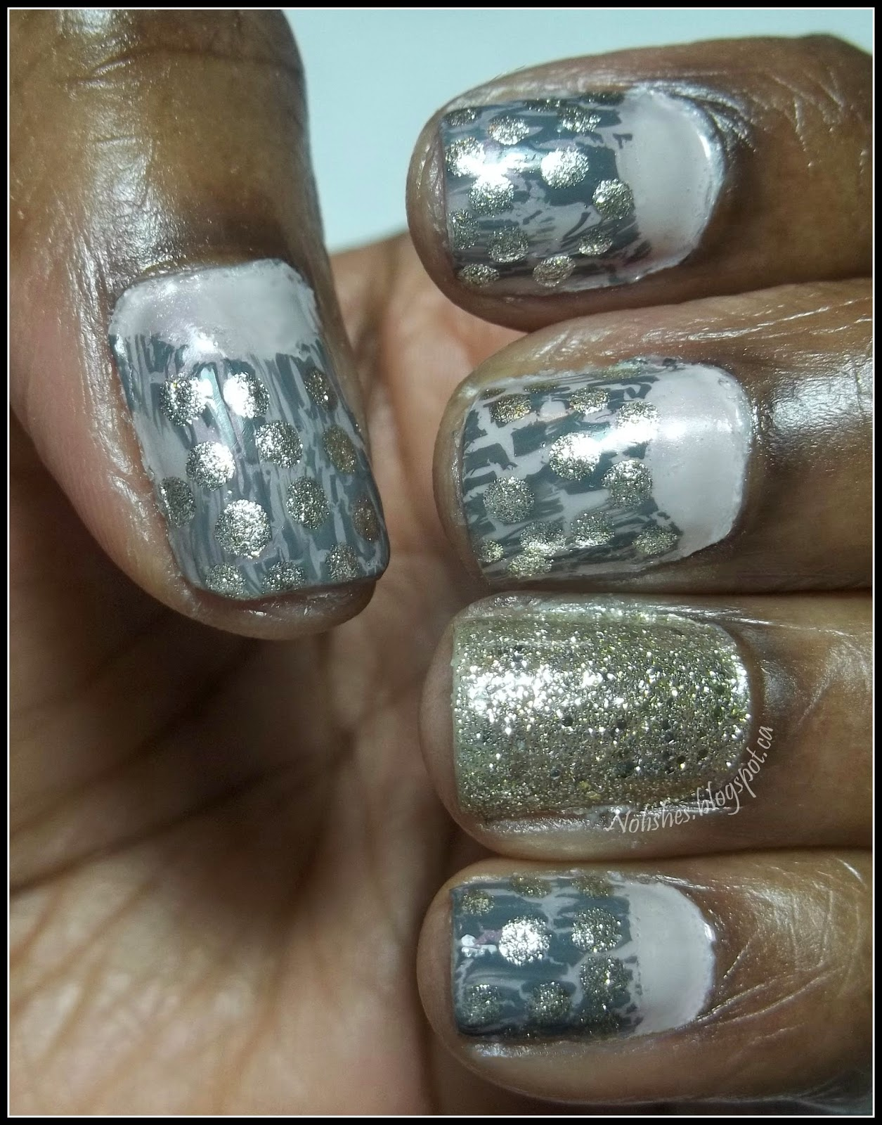 A nail stamping manicure using crackle nail polish as the background for a dotticure to give a 'studded leather' effect. All nails except the ring finger feature pink half-moons at the base, and grey crackle polish over a pink base on the upper portion. The grey crackle polish is also covered in white gold dots. The ring finger features white gold glitter over the whole nail.