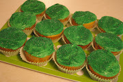 I frosted each cupcake, added some green sugar sprinkles to the top, .
