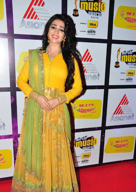 Beautiful Actress Charmi Kaur in Yellow Dress