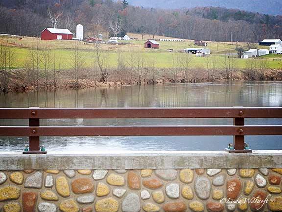 farm seen from a bridge