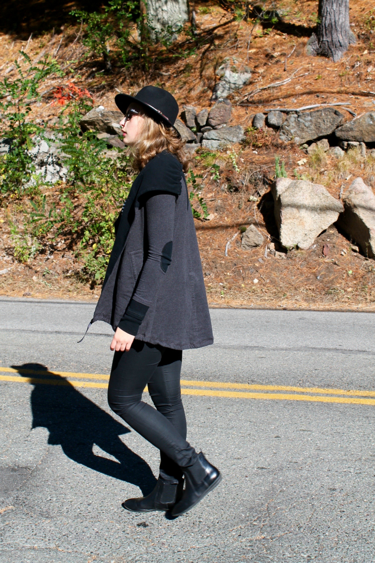 Black outfit with a Lululemon vest and fedora