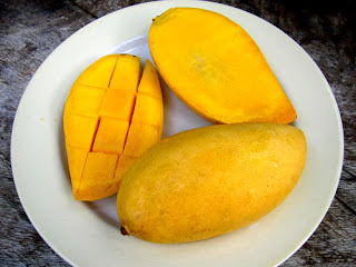plate of yellow mango