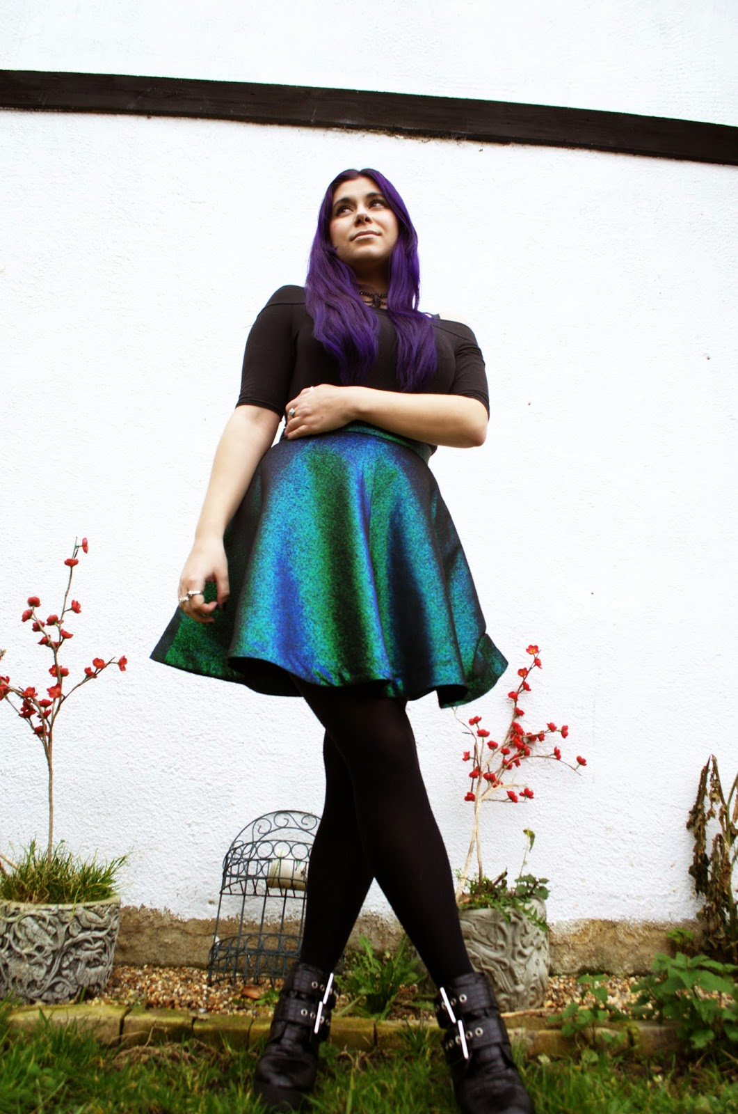 Grunge style with metallic skirt and bardot top.