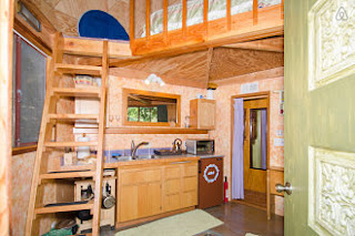 Downstairs at the Mushroom Dome Cabin is a kitchen, sitting area and bathroom.