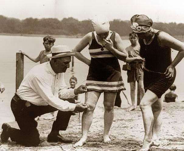 Beach police measuring female swimsuits