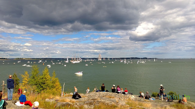 last tall ships leaving Helsinki escorted by countless small boats