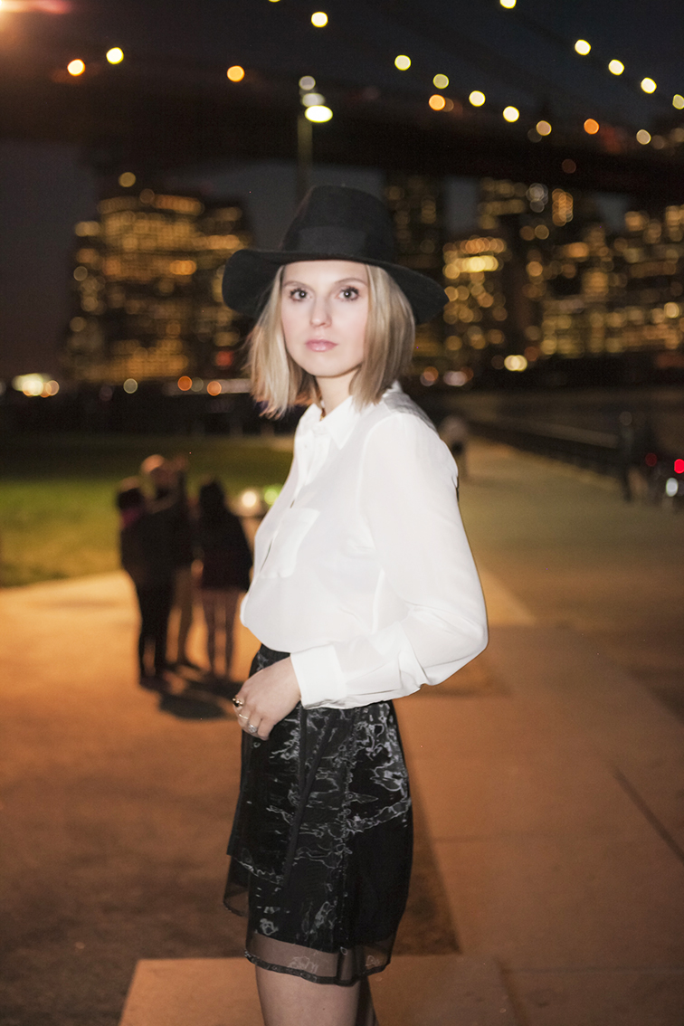 Brooklyn at night, dragging the shutter, flash photography, fashion over reason photographed by Ian Rusiana, wide brim felt hat, white blouse, Stefanie Biggel foil shorts