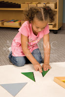 child playing with shapes mat NAMC montessori perspectives what is normalization