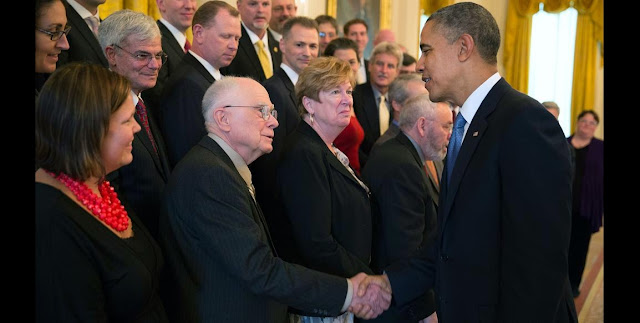 President Barack Obama congratulates William Borucki on being a finalist for the Samuel J. Heyman Service to America Medal in the East Room of the White House, Oct. 23, 2013. Image Credit: Official White House Photo by Pete Souza