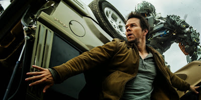 Image of Mark Wahlberg and Autobots in Transformers Age of Extinction