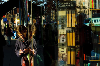 A lady checks her text messages outside KramerBooks in Dupont Circle, Washington, DC.