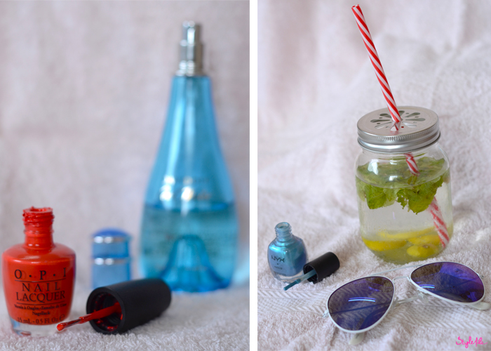 Assortment of summer perfumes, nail polishes, infused water in a mason jar and sunglasses
