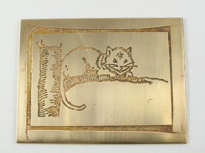 etched brass Cheshire cat