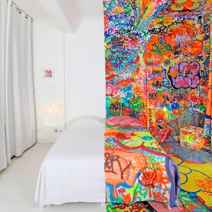 Habitación de hotel con doble personalidad es mitad prístino, mitad graffiti