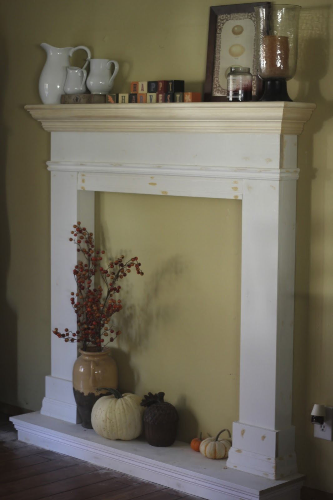in white we first painted the back of the fireplace with chalk paint