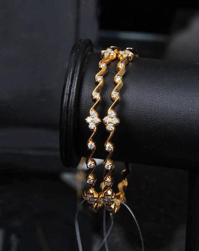 Indian Jewellery Designs: Slim diamond bangles in gold