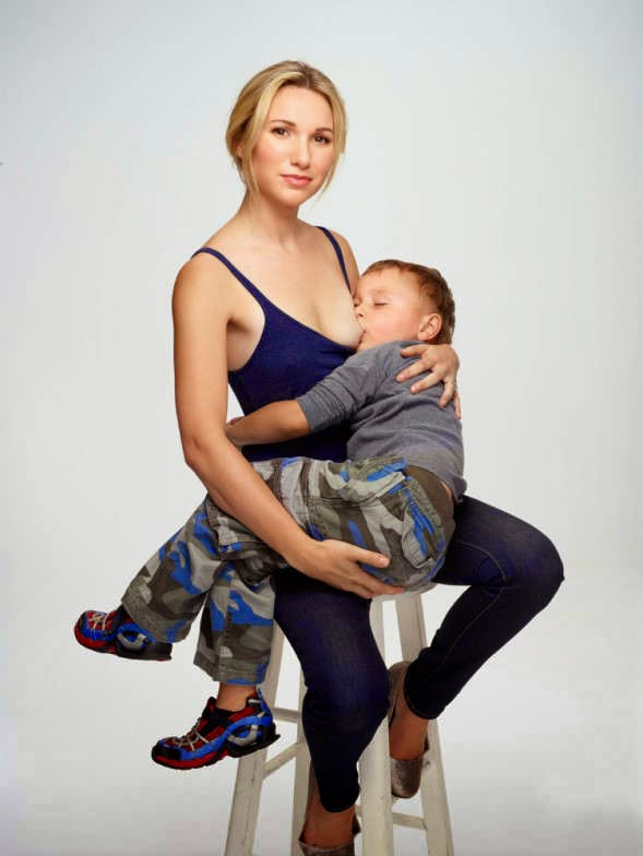 model posing nude while breastfeeding her baby stirs up the