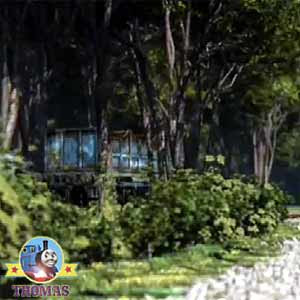 Steam locomotive Thomas the train overgrown trees and bushes traditional railway old carriage truck