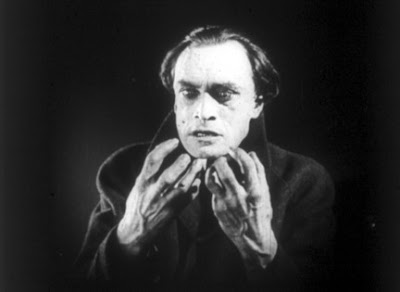 Orlac gazes upon his monstrous hands