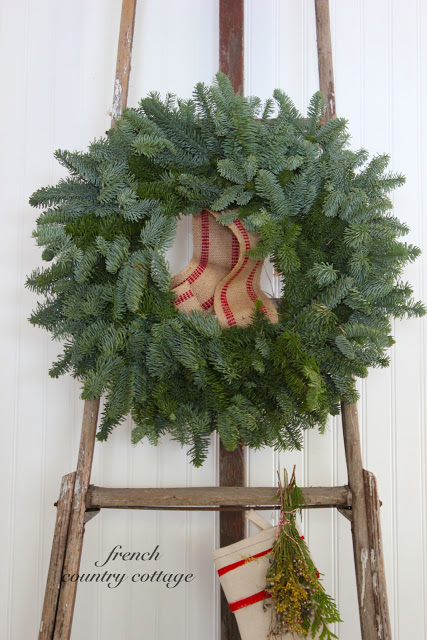 Christmas orchard ladder for hanging a wreath and stockings - gorgeous idea by French Country Cottage, featured on I Love That Junk
