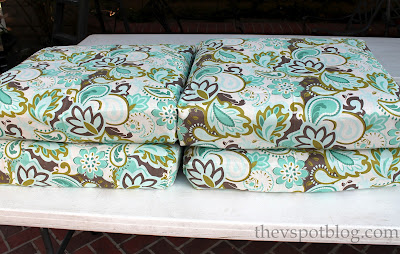 Finished chair cushions with new fabric hot glued on
