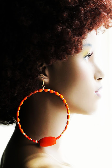 african orange beaded hoop earrings