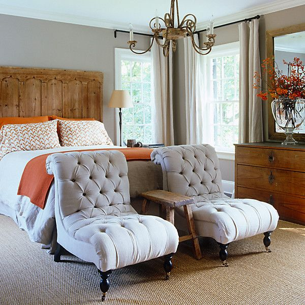 bedroom with gray slipper chairs