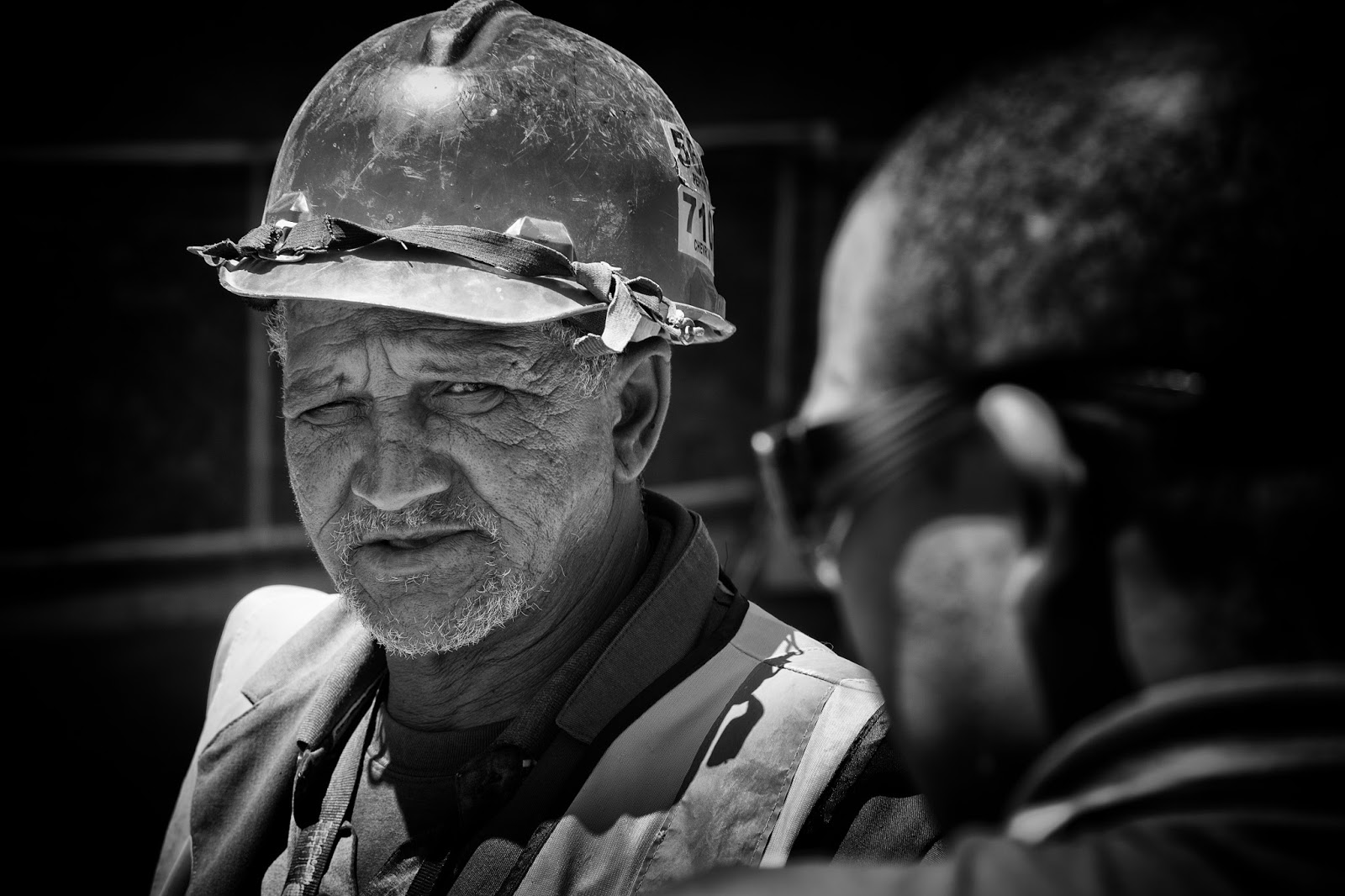 A candid street portrait of a construction worker shot in Cape Town South Africa