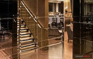 foto de espelho para parede com bisote na cor bronze