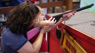 Child and mother shooting air riffle at Santa Land at Bass Pro Shops