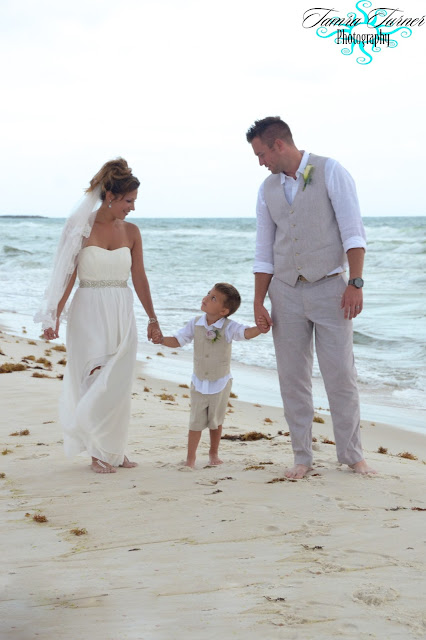 a walk on the beach on their wedding day