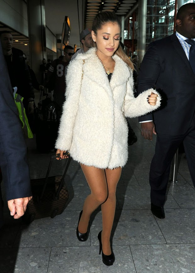 Ariana Grande, Sexy in a fur coat at the airport in London