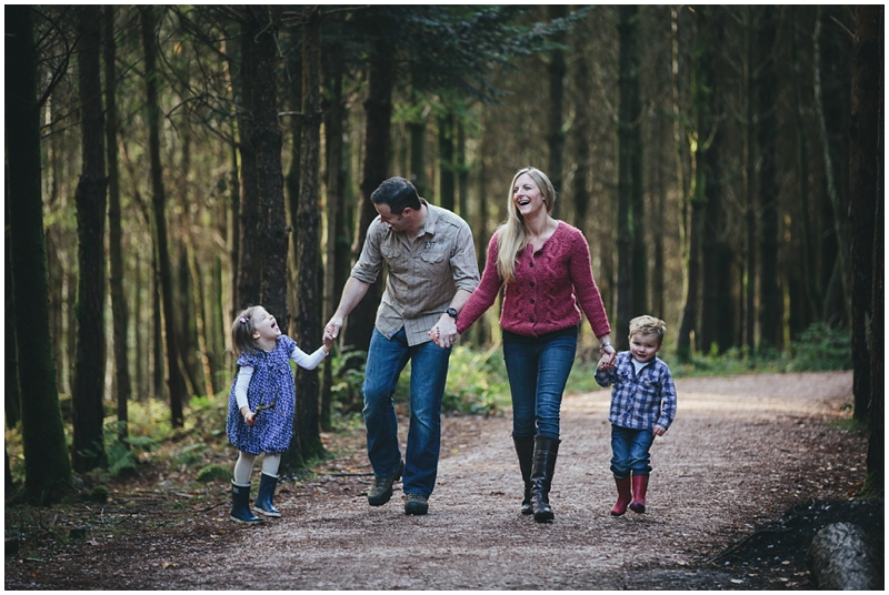 A family walking in the forest together