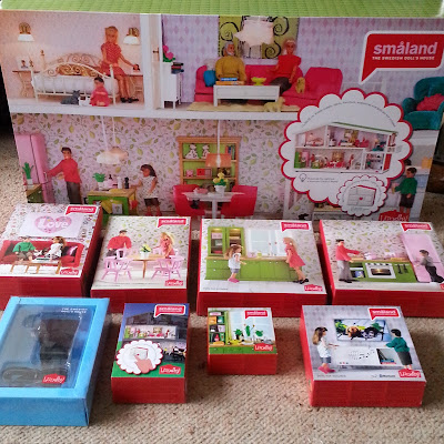 Selection of Lundby dolls' house and furniture sets in packaging.