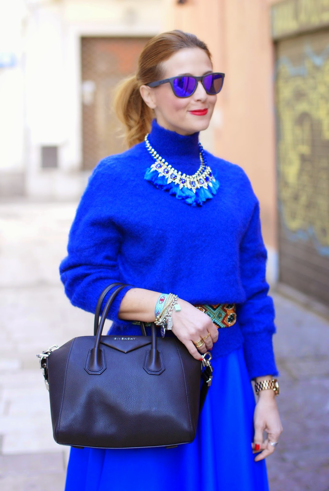 cobalt blue midi circle skirt, Givenchy Antigona bag, turtleneck sweater with tassel necklace, Fashion and Cookies, fashion blogger