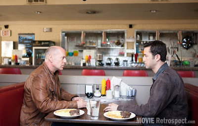 Bruce Willis and Joseph Gordon-Levitt as old and young Joe, meet in the diner for a stand off