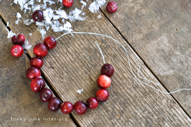 cranberry garland / Christmas old window picture in the kitchen, viahttp://www.funkyjunkinteriors.net/