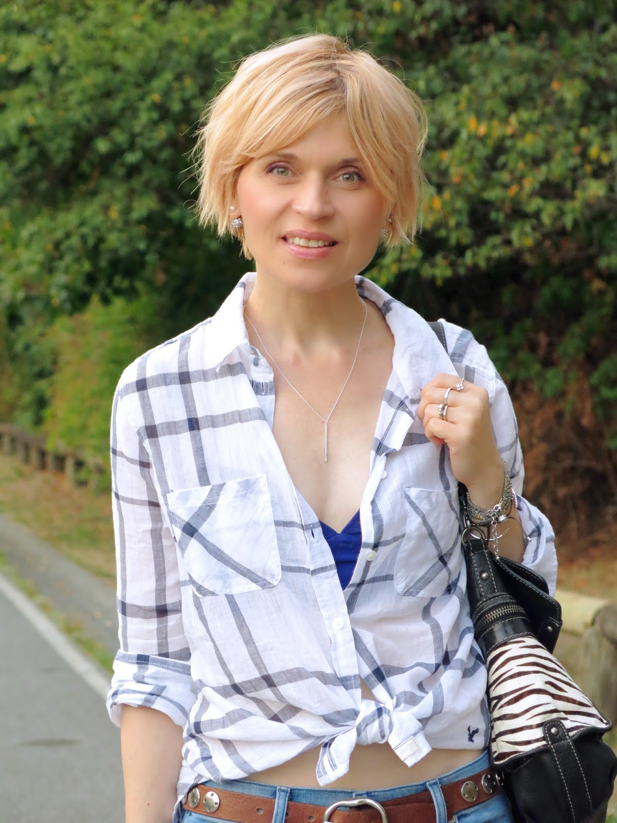 white plaid shirt, Fossil bag, and accessories