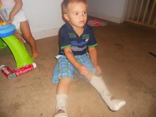 put on socks all by himself